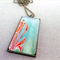Decorative original painted pendant necklace; orange; red, white, blue, green