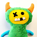 Green dot monster soft toy