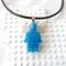 LEGO MANIA - Resin Lego man pendant hand cast in sparkly aqua glitter resin