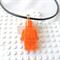 LEGO MANIA - Resin Lego man pendant hand cast in sparkly orange glitter resin
