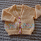 Size 6-12 months hand knitted cardigan; apricot & multi colour, girl, washable,