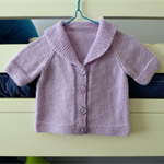 Hand knitted mauve wool baby cardigan - to 6 m. size - cute feature on back