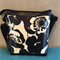 Black Vinyl Panel Messenger Bag: Bold Black floral on Natural