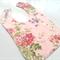 Floral on pink bib