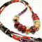 Speckled Egg Ceramic Beads on  Black/Red Kimono Cord Necklace