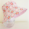 Girls hats in bright floral pattern