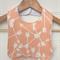 Organic Baby Bib in Peach Arrows