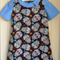 Sugar Skulls dress with collar & sleeves, size 5. Exposed zip.