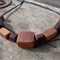 Necklace made from timber beads hand tooled from reclaimed hardwoods and cedar