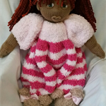 Knitted doll in pink jumpsuit
