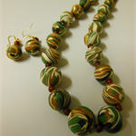 Necklace & earring set in green, cream, black &gold