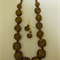 Necklace & earring set in brown, green & gold