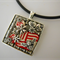 Pendant, square, silver plate charms, red & white polymer pieces, neoprene cord