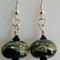 Black lampwork earrings with silver trails