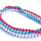 Paris Multi-strand red Cream and Blue Necklace by Sasha+Max Studio