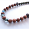Jardin glass and wooden necklace by Sasha+Max Studio
